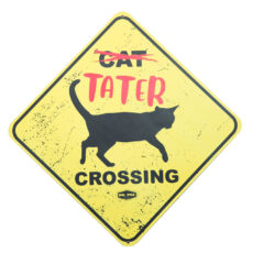 This image has a yellow sign with cat scratched off, below the word Tater in red bold letters. Below the text is a silhouette of a black cat with the word crossing below the cat. At the very bottom is the DR.Pol logo.